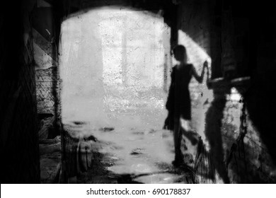 The shadow of a lone woman in an abandoned old ruined house-Ghost (black / white photo)