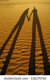 Shadow of  loving couple on the beach sand