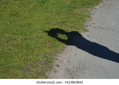 shadow of a man with a camera