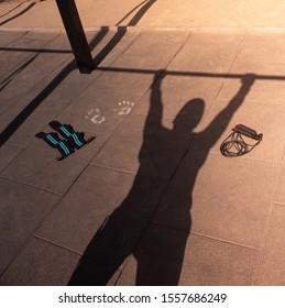 shadow of a man doing calisthenics