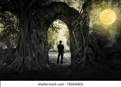 Shadow of the man in full moon in the night at old temple