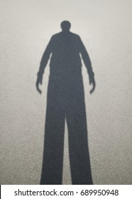 Shadow of man on the asphalt
