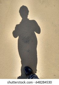 Shadow of man in the sand