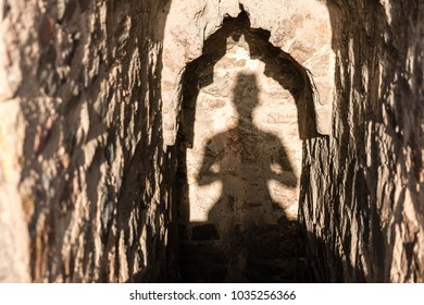 shadow meditation concept in morning, traditional ritual, sunrise sunset, ancient old Indian building
