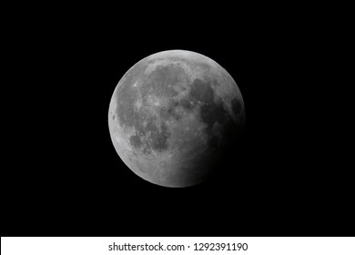 Earth's shadow is moving off the moon's surface following a total lunar eclipse.