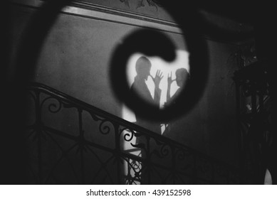 Shadow on the wall of romantic couple b&w