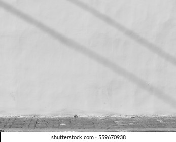 shadow on a white wall street