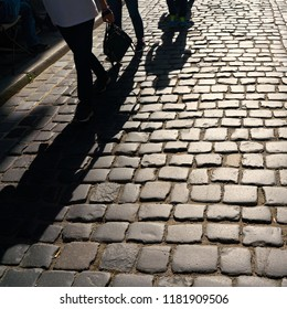 Shadow of oncoming pedestrians on cobblestone in the old town of Quedlinburg
