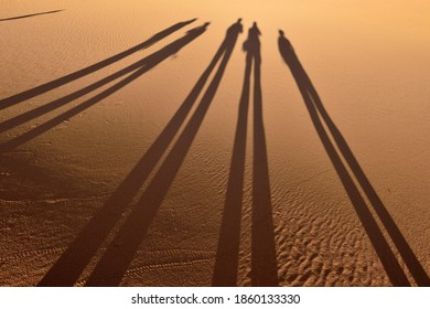 Shadow of people on a sanddune, Tassili n´ Ajjer National Park, Unesco World Heritage Site, Sahara desert, North Africa, Algeria