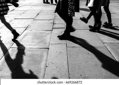 Shadow of People walking in crowded street. Black and White photo of shadow of people. Pedestrian in a street.