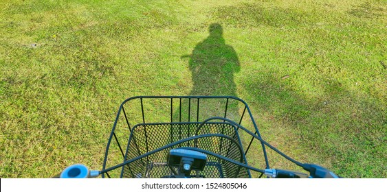 the shadow of the person on the grass