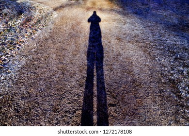 shadow of person on winter day at sunset