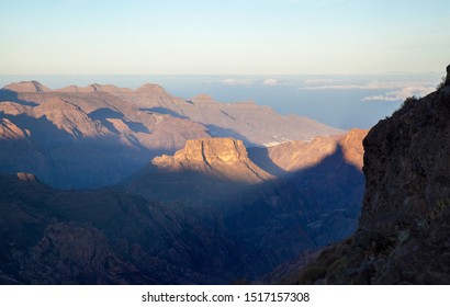 Shadow of Roque Bentayga, one of the most iconic rock formation of the island f Gran Canaria, as seen from the east, morning light