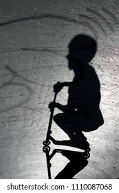 Shadow scooting by at the skate park