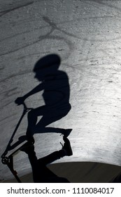 Shadow a scooting by at the skatepark