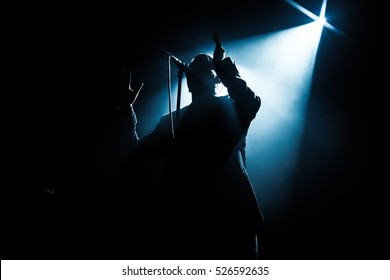 Shadow of singer in light