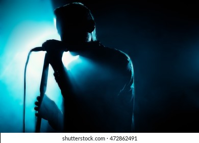 The Shadow Of The Singer. Silhouette in blue light