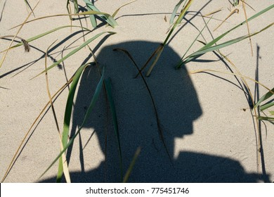 A shadow of a soldier in a combat military helmet. Post combat disorder, combat stress reaction is a big problem for military veterans of combat conflicts.