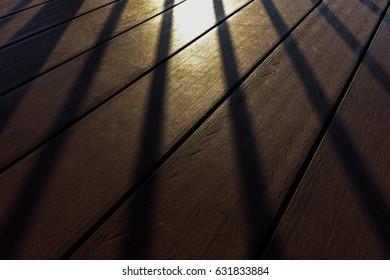 Shadow and sun light on the brown wood floor