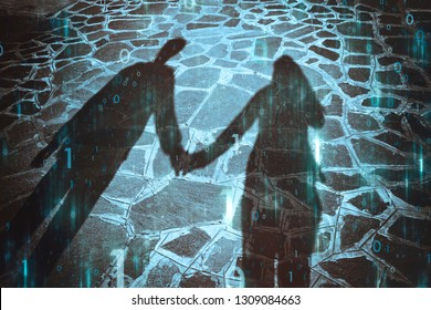 Shadow of two people holding hands together with artistic computer cyberspace binary numbers data background.