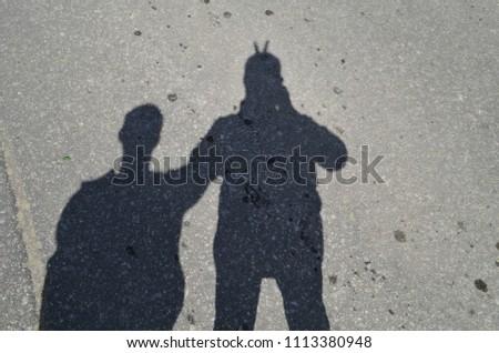 Shadow Two People On Asphalt Stock Photo (Edit Now) 1113380948 ... 7fb60f28c5