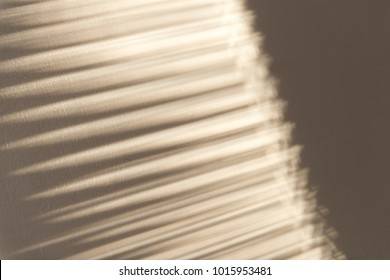 Shadow of window blinds on a wall for backgrounds