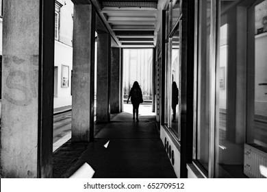 shadow of woman walking on city street