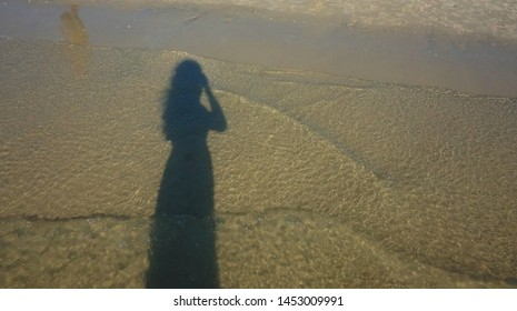 The shadow of women on the beach