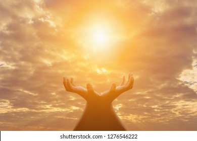 Shadow,A young woman praying for God's blessings with the power and power of the sacred, giving herself luck and showing her forgiveness with the power of religion, faith, worship, Christian concept