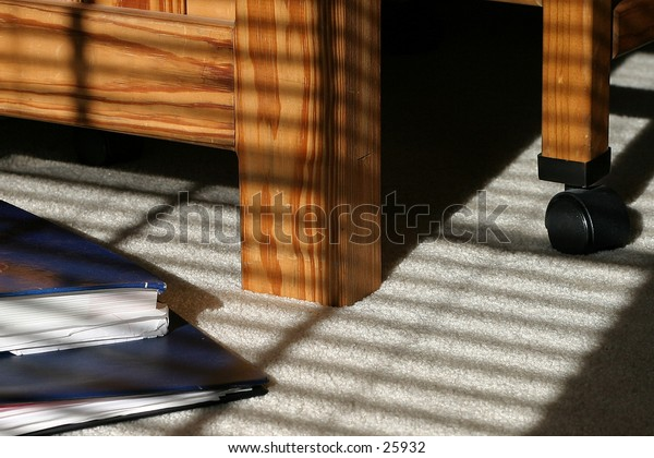 Shadows cast by blinds on the floor