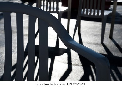 Shadows of chairs in bright sun.