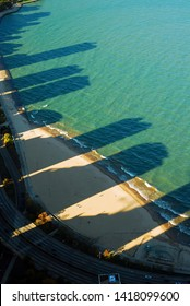 Shadows of the Chicago skyline extend into Lake Michigan