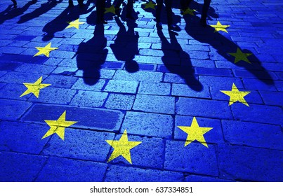 Shadows group of people walking on sunny stone tiled street floor painted with European Union flag.