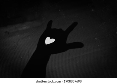 shadows of hands holding a heart valentines day