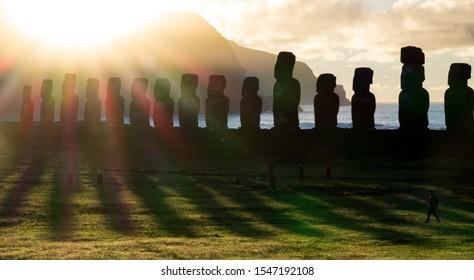 Shadows and lights on Ahu Tongariki moais at dawn in Rapa Nui
