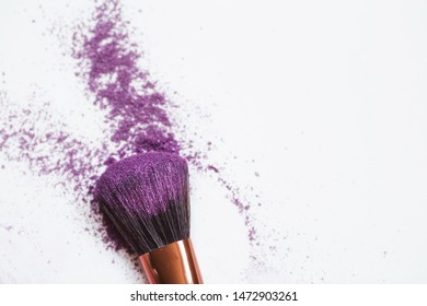 Shadows and makeup brush isolated on white.