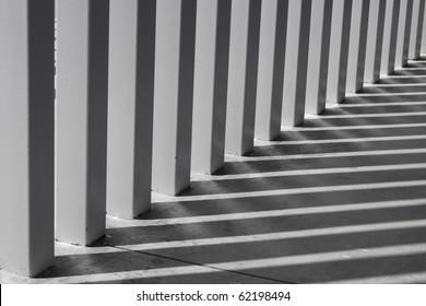 Shadows on modern columns on the floor as abstract art