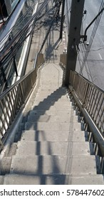 shadows on the overpass stairs