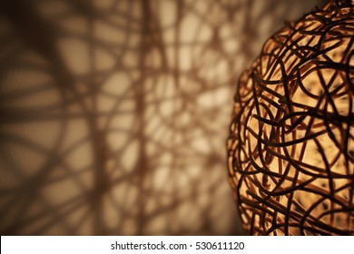 Shadows on the wall of openwork lamp. Selective focus