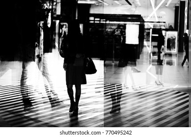 Shadows of people in the shopping centre (double exposure)