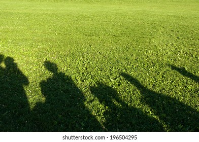 Shadows of people taken on a sunny day.