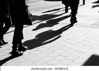 Shadows of people walking in Manchester, UK