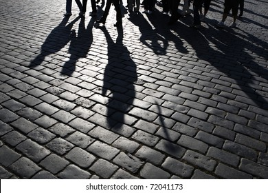 Shadows of people walking in a street of the city, Prague.