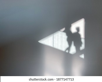 Shadows of two people in triangular shape