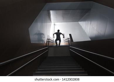 Shadows of weirdo in a station