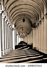 shadows of the wonderful architectural arcades  in Vicenza in Italy with sepia toned effect