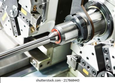 shaft detail turning on metal cutting machine tool at manufacturing factory