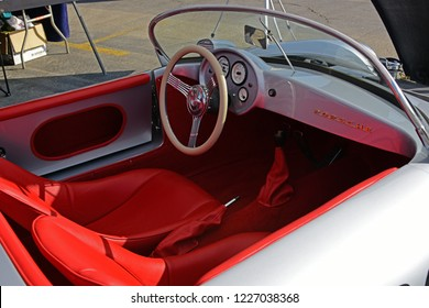 SHAFTER, CA - NOVEMBER 3, 2018: The Wings N' Wheels exhibition at Minter Field features the smooth lines and styling of this Porsche 550 Spyder in the colors and markings of the James Dean car in whic