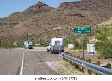 SHAFTER,TX,USA-MAY 30: RV travelers visit Shafter ghost town on May 30, 2013. Recreational vehicles transport residents and foreign tourists to many remote areas of the United States.
