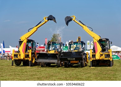 Shaftesbury, Dorset, UK - August 17, 2016: The Diggerland Dancing Digger Stunt Team entertains the crowd at an agricultural show